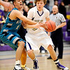 Boulder's Riley Grabau (right) works in for a shot while being guarded by Westminster's Jesus Merjil (left) during their basketball game at Boulder High School in Boulder, Colorado February 23, 2010.  CAMERA/Mark Leffingwell