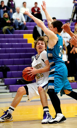 Boulder's Riley Grabau (left) is pressured by Westminster's Aaron Quirk (right) during their basketball game at Boulder High School in Boulder, Colorado February 23, 2010.  CAMERA/Mark Leffingwell