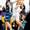 Boulder's Zack Wilson (right) is fouled by Westminster's Greg Stephens (right) during their basketball game at Boulder High School in Boulder, Colorado February 23, 2010.  CAMERA/Mark Leffingwell