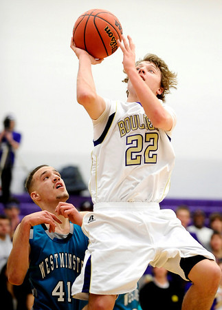 Boulder's Riley Grabau (right) takes a shot over Westminster's Erik Markoff (left) during their basketball game at Boulder High School in Boulder, Colorado February 23, 2010.  CAMERA/Mark Leffingwell