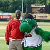 "Former Redskin Dexter Manley poses for a picture with the Baysox mascot ""Louie""."
