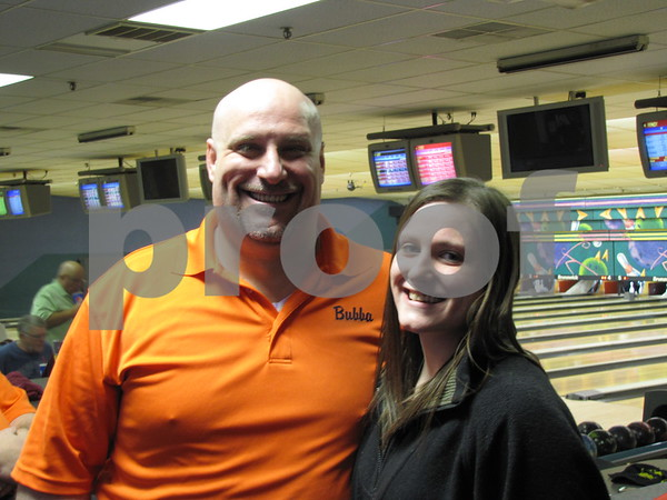 Bubba Johnson and his daughter Baylee Johnson.  Baylee was there to watch her dad and his team bowl.