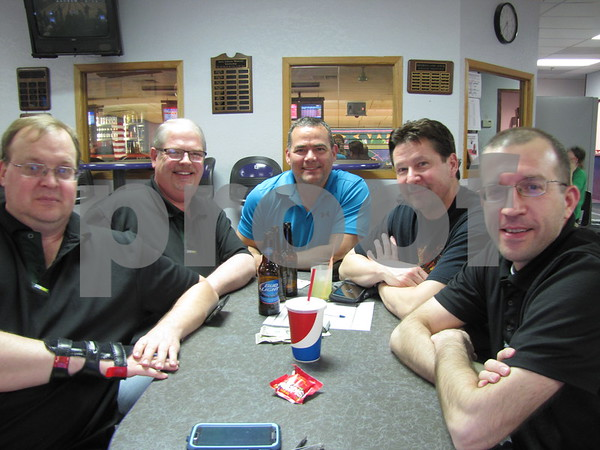 Curt Esp, Terry Pavel, Ted Camamo, Bill Barber, and Chris Yoder enjoying a night of bowling and camaraderie.