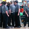 D-B boys huddle-up before the sectional match as Coach Knotts goes to check on the girls. Photo by Ned Jilton II