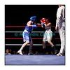 Traditionnel meeting de boxe de Pâques dans la salle polyvalente de Palézieux, organisé par le Boxing-Club de Châtel-St-Denis.<br /> Ici, le match Cornelia Schmidt (en rouge) - battue aux points (unanimité) - contre Anaïs Kistler (en bleu).