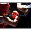 Samedi 7 avril 2012: traditionnel meeting de boxe organisé à Palézieux par le Boxing-Club de Châtel-St-Denis.<br /> <br /> Ici, Bojan Todosjevic, BC Châtel-Saint-Denis (rouge) reçoit un coup fatal de Barbezat Robert, BC Martigny (bleu). Todosjevic, qui ira au tapis plus tard dans le match, perdra par jet de l'éponge à l'appel du 3e round.