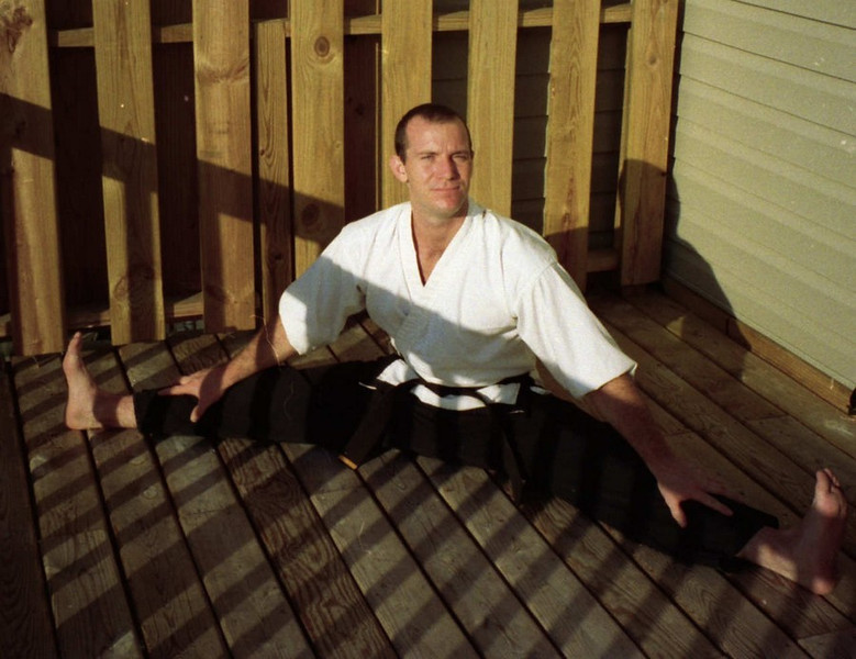 black belt stretching patio nhb fighter backyard