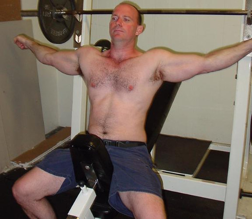incline bench pressing man stretching hairychest