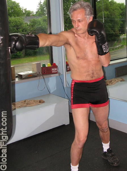 a 60ish years fit older man boxing