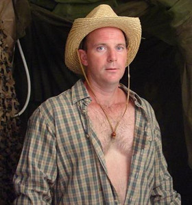 cowboy straw hat opened shirt hairy chest