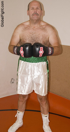 daddyboxer wearing boxing gloves