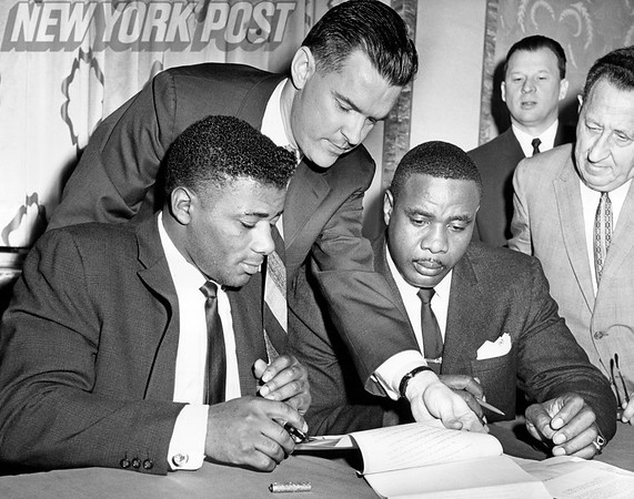 Floyd Patterson and Sonny Liston sign the contract for the next World Heavyweight Championship Bout. 1962