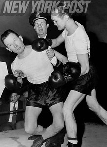 Boxer Fritzie Zivic shows comedian Fred Allen how to throw a right hook. 1943