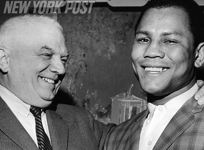 Newly crowned Light Heavyweight Champion Jose Torres and trainer Cus D'Amato. 1965