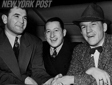 Promoter Joe Gould between opponents Tommy Farr and Jim Braddock. 1938