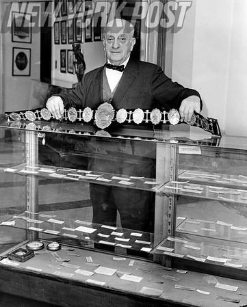 Nat Fleischer Owner of Boxing Museum, holds up $10000 diamond-studded belt once owned by John L. Sullivan. 1965