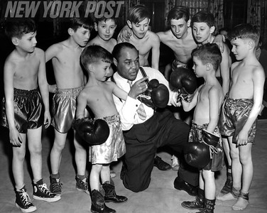 """Henry """"Hank"""" Armstrong gives pointers to young aspiring boxers. 1954"""