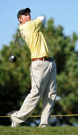 GOLF01<br /> Monarch's Jay Byrne tees off during the final round of the 5A State Championships in Aurora on Tuesday.<br /> Photo by Marty Caivano / The Camera / Oct. 6, 2009