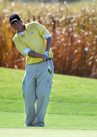 GOLF08<br /> Monarch's Jay Byrne chips onto the green during the final round of the 5A State Championships in Aurora on Tuesday.<br /> Photo by Marty Caivano / The Camera / Oct. 6, 2009
