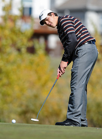 GOLF07<br /> Fairview's Sam Rock putts during the final round of the 5A State Championships in Aurora on Tuesday.<br /> Photo by Marty Caivano / The Camera / Oct. 6, 2009