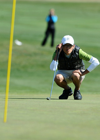 GOLF06<br /> Fairview's Ethan Park analyzes a putt during the final round of the 5A State Championships in Aurora on Tuesday.<br /> Photo by Marty Caivano / The Camera / Oct. 6, 2009