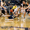 Record-Eagle/Jan-Michael Stump<br /> Traverse City St. Francis' Michael Jenkins (32) looks to pass after stealing the ball from Negaunee's Zach Marshall (24) in Tuesday's state quarterfinal game in Petoskey.