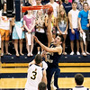 Record-Eagle/Jan-Michael Stump<br /> Traverse City St. Francis' Kody Kleinrichert (3) shoots over Negaunee's Brock Weaver (3) in Tuesday's state quarterfinal game in Petoskey.