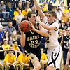 Record-Eagle/Jan-Michael Stump<br /> Traverse City St. Francis' Michael Jenkins (32) tries to drive past Negaunee's Andrew Katona (32) in Tuesday's state quarterfinal game in Petoskey.