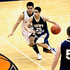Record-Eagle/Jan-Michael Stump<br /> Traverse City St. Francis' Damon Sheehy (25) drives past Negaunee's Zach Marshall (24) in Tuesday's state quarterfinal game in Petoskey.