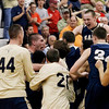 Record-Eagle/Jan-Michael Stump<br /> Traverse City St. Francis players celebrate the 71-60 win over Negaunee in Tuesday's state quarterfinal game in Petoskey.