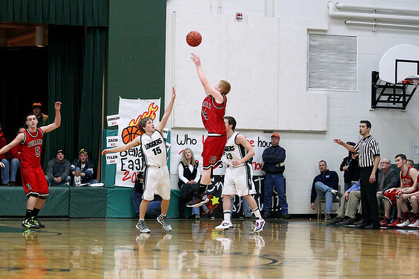 Record-Eagle/Keith King<br /> Bellaire's Tyler Thornton shoots the ball for a basket at the closing seconds of the third quarter against Boyne Falls Friday, March 9, 2012 at Boyne Falls Public School.