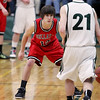 Record-Eagle/Keith King<br /> Bellaire's Zach Smith defends Boyne Falls' Brendon Matelski Friday, March 9, 2012 at Boyne Falls Public School.