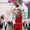 Record-Eagle/Keith King<br /> Bellaire's Gus Meriwether shoots the ball against Boyne Falls' Brendon Matelski Friday, March 9, 2012 at Boyne Falls Public School.