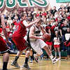 Record-Eagle/Keith King<br /> Boyne Falls' Logan Jenkins takes the ball in against Bellaire's Mitch Teetzel Friday, March 9, 2012 at Boyne Falls Public School.