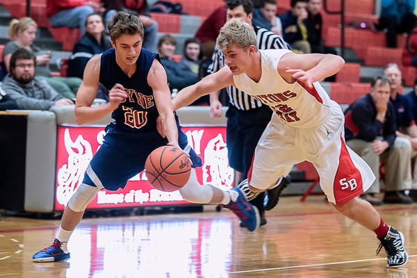 Record-Eagle/Pete Rodman<br /> Boyne City's Dalton Gardner, left, and Suttons Bay's Devin Capron battle for the ball during a high school boys basketball game at Suttons Bay High School on Thursday.