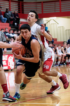 Record-Eagle/Pete Rodman<br /> Boyne City's Zach Napont, left, drives to the net past Suttons Bay's Mac Alexander during a high school boys basketball game at Suttons Bay High School on Thursday.