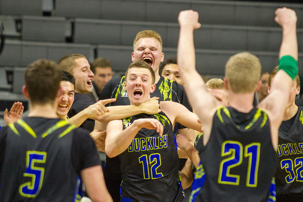 Record-Eagle/Brett A. Sommers Buckley's Austin Harris (12) is grabbed from behind by teammate Nick Kuhn  after winning Thursday's Class D state semifinal at East Lansing's Breslin Center. Buckley won 68-61.