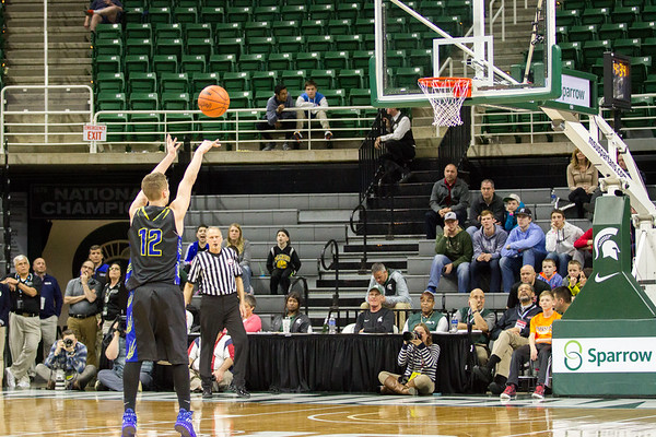 Record-Eagle/Brett A. Sommers Buckley's Austin Harris attemps a technical free throw during Thursday's Class D state semifinal at East Lansing's Breslin Center. Buckley won 68-61.