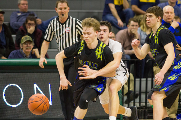 Record-Eagle/Brett A. Sommers Buckley's Ridge Beeman is fouled by a Lansing Christian defender during Thursday's Class D state semifinal at East Lansing's Breslin Center. Buckley won 68-61.
