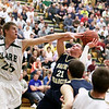 Record-Eagle/Keith King<br /> Traverse City St. Francis' Byron Bullough has his shot contested by Clare's James Wezensky Wednesday, March 14, 2012 at Traverse City West High School.