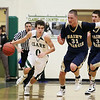 Record-Eagle/Keith King<br /> Clare's Tanner Vida dribbles the ball against Traverse City St. Francis' Sean Sheldon (31) and Kody Kleinrichert (3) Wednesday, March 14, 2012 at Traverse City West High School.