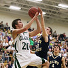 Record-Eagle/Keith King<br /> Clare's Shane Adkins has his shot contended by Traverse City St. Francis' Michael Jenkins Wednesday, March 14, 2012 at Traverse City West High School.