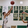 Record-Eagle/Keith King<br /> Clare's Taylor Ardis shoots the ball against Traverse City St. Francis Wednesday, March 14, 2012 at Traverse City West High School.
