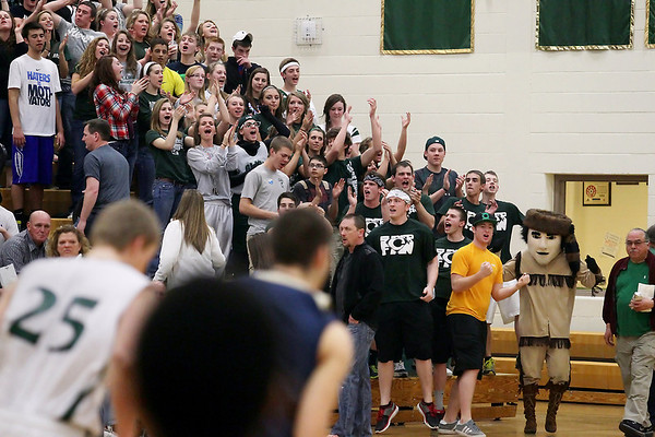 Record-Eagle/Keith King<br /> Clare High School fans cheer as their team scores points against Traverse City St. Francis High School Wednesday, March 14, 2012 at Traverse City West High School.