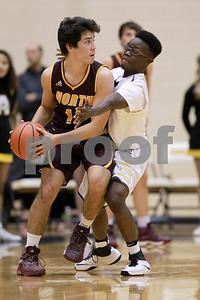 Avon High School senior Andrew Short (12) with the tight defense on Bloomington North High School senior Sean Rudder (11) during the game between Bloomington North vs Avon at Avon High School in Avon,IN. (Jeff Brown/Flyer Photo)