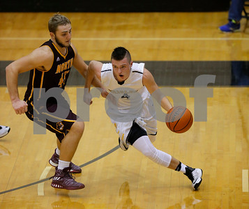 Avon High School senior Hayden Crowder (4) drives the ball up court past Bloomington North High School forward Logan Calvin (45) during the game between Bloomington North vs Avon at Avon High School in Avon,IN. (Jeff Brown/Flyer Photo)
