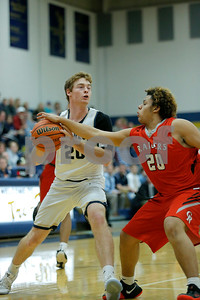 Tri-West High School forward Jake Hill  (20) is fouled by Indianapolis Cardinal Ritter High School junior Tharran Coook (20) as he drives to the basket during the game between Cardinal Ritter vs Tri-West at  Tri-West High School in Lizton,IN. (Jeff Brown/Flyer Photo)