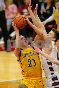 Crawfordsville High School small guard Cameron Harris(20) powers his way up and over Danville High School guard Connor Jones (11) for the score during the game between Crawfordsville and Danville at Danville High School in Danville,IN. (Jeff Brown/Flyer Photo)