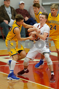 Danville High School forward Zach Callahan (22) battles with Crawfordsville High School small guard Cameron Harris(20) for control of the rebound during the game between Crawfordsville and Danville at Danville High School in Danville,IN. (Jeff Brown/Flyer Photo)