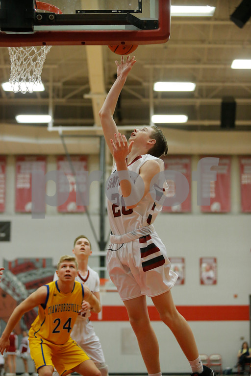 Danville High School forward Dillon Ware (20) puts the rebound back in for two to close out the first quarter of play during the game between Crawfordsville and Danville at Danville High School in Danville,IN. (Jeff Brown/Flyer Photo)